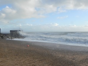 Sea breaking on a breakwater at Hastings UK Christmas Day 2012