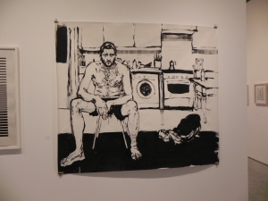 A drawing of a man sitting in the kitchen clothed only in boxer shorts
