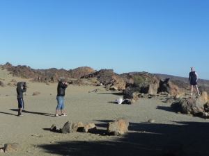Two photographers take photographs of a man standing in the National Park, Tenerife