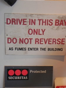 A sign saying drive in thie bay only do not reverse at the old Hastins Art School