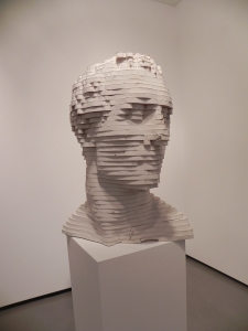 Scultpure of a head in layers by Scott Carter