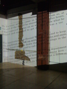 Printed words appear in the corner of the exhibition space in the Printworks