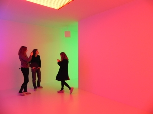 Three figures stand in Carlos Crusz-Diez's Chromosaturation in the Hayward Gallery