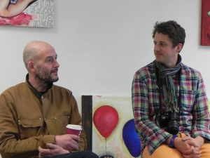 Jake Chapman and unintroduced bloke talking to art students at Sussex Coast College