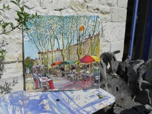 A painting by Jean-Claude Roy is on a table outside his studio