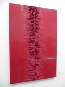 A red painting created in wax by Kate Linforth
