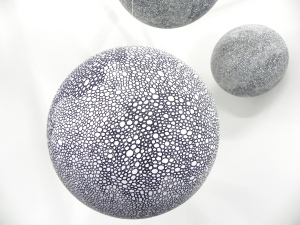 Three spheres are shown, part of of te work by Sarah Rilot